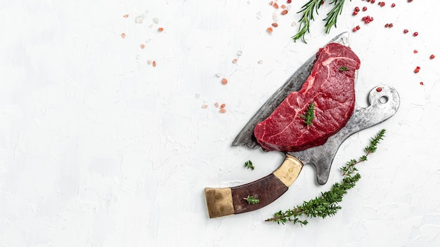 Pieces of cooked rump steak with spices served on old meat butcher. steak of marbled beef black angus. raw beef ramp steak, top view.