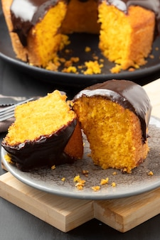 Pieces of delicious carrot cake covered with chocolate.