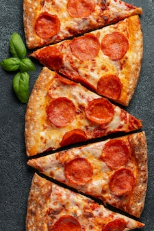 Pieces of delicious pepperoni pizza.