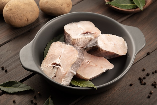 Pieces of fresh hake on plate