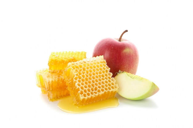Pieces of honeycomb and apple isolated on white background, close up