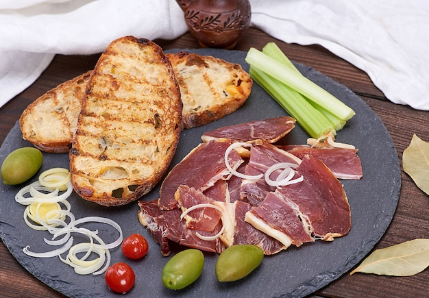 Pieces of jamon and white fried bread for a sandwich