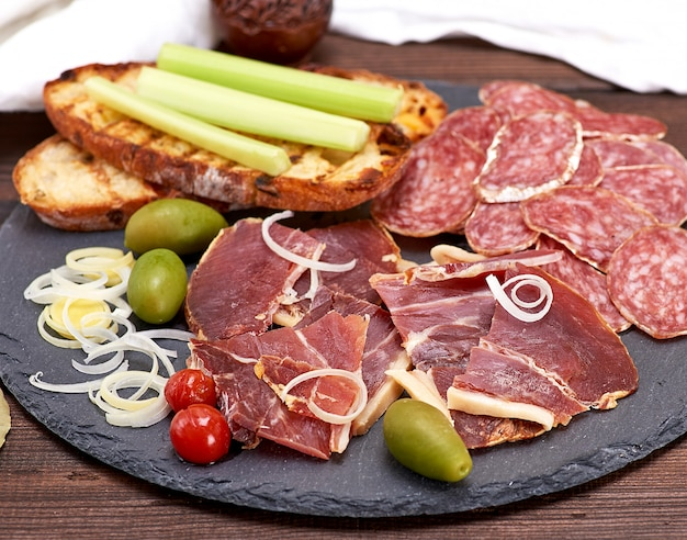 Pieces of jamon and white fried bread