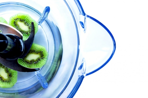 Pieces of juicy fruit kiwi in a blender. selective focus. isolated on white