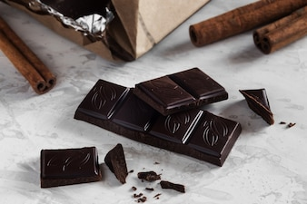 Pieces of dark chocolate with cinnamon