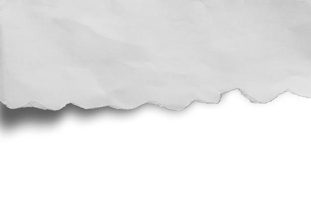 テキストのコピースペースと破れた紙のテクスチャの背景の断片