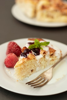 Pieces of pie with cheese with fruits. hoemmade cottage cheese pie, pastry or bakery concept.