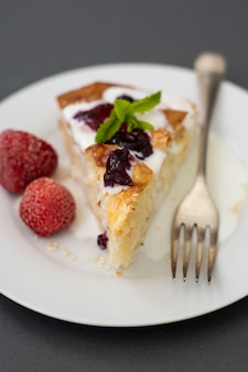 Pieces of pie with cheese with fruits. hoemmade cottage cheese pie, pastry, bakery.