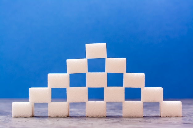 Pieces of refined sugar laid out in the form of a pyramid