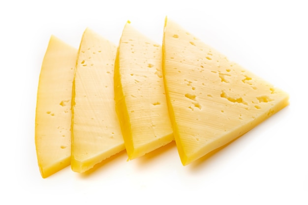 Pieces of semi-hard or hard yellow cheese with holes isolated on a white background.
