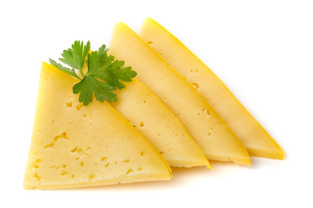 Pieces of semi-hard or hard yellow cheese with holes and parsley leaf isolated on a white background.
