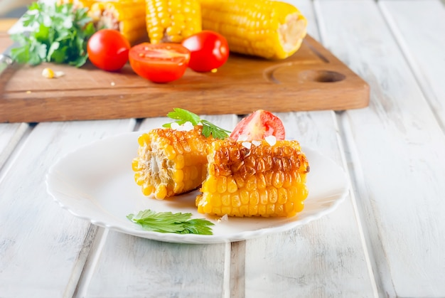 Pieces of sweet corn grilled in tin foil