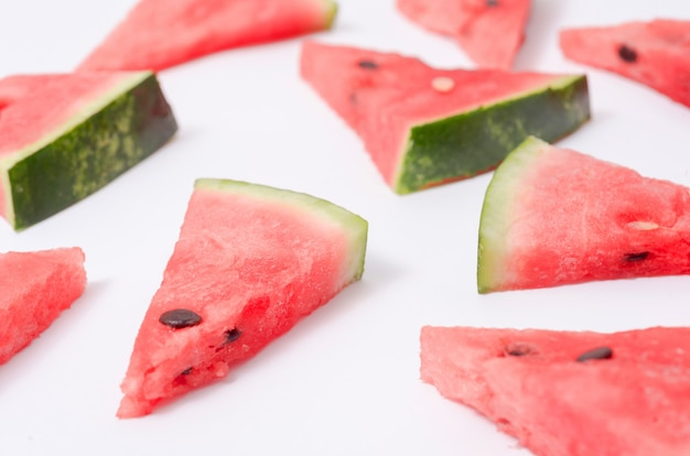 Pieces of watermelon on white surface