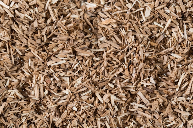 Pieces of wood chip smoking element giving flavor and taste many elements pattern natural beige.