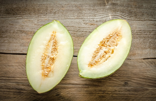 Piel de sapo melon on the wooden background