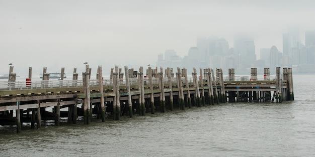 Pier at upper new york bay, liberty island, new york harbor, manhattan, new york city, new york stat