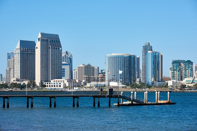 Pier with kayak boats, downtown skyline  in san diego