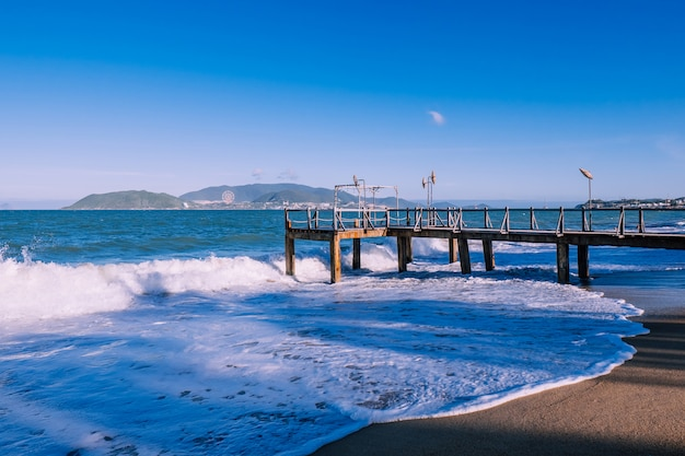 Pier with splashes of water. island