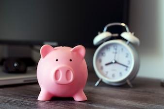 Pig money box with clock