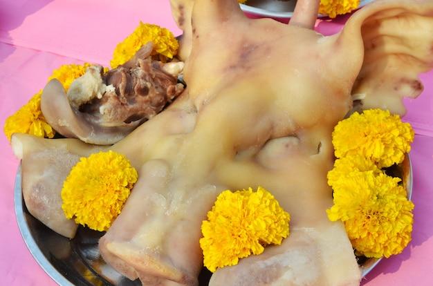 Pig's head chopped off for sacrifice