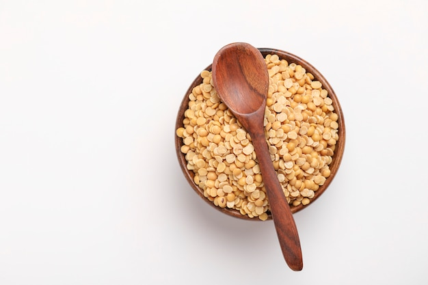 Pigeon pea also known as toor dal in wooden bowl and spoon