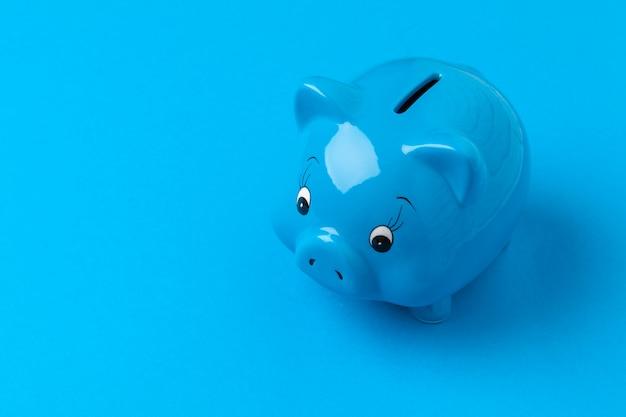 Piggy bank on blue color