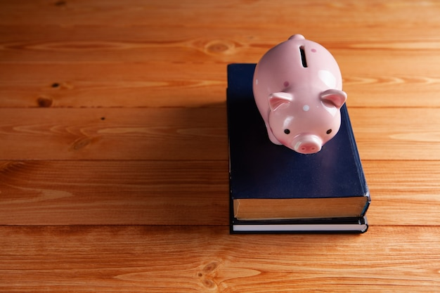 Piggy bank and books on the table