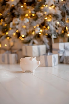 Piggy bank in close up on festive christmas atmosphere