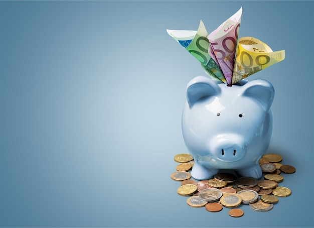 Piggy bank and coins and money on background
