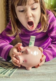 Piggy bank and dollars. selective focus.