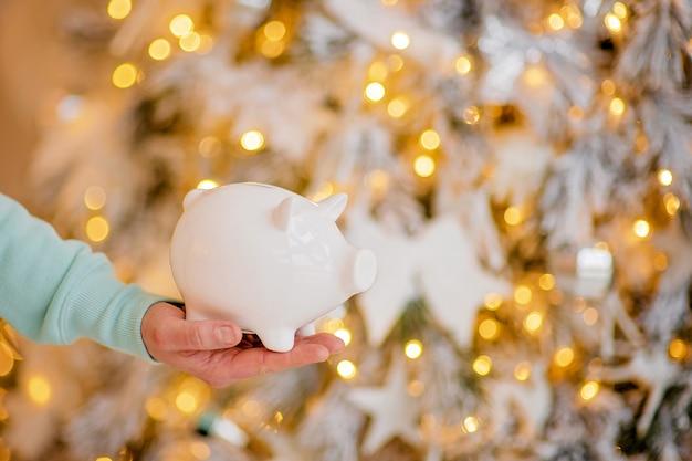 Piggy bank in festive atmosphere