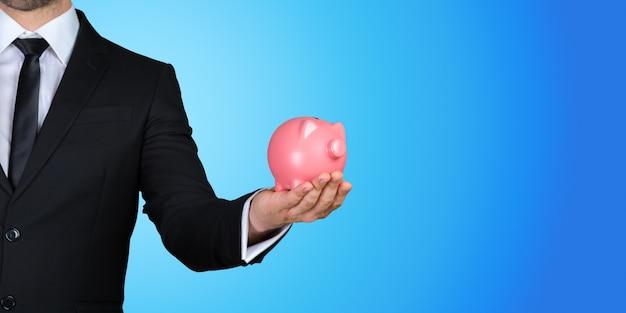 Piggy bank in hand