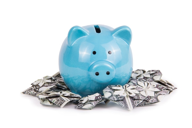 Piggy bank and heart from a bill