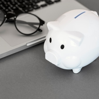 Piggy bank next to laptop