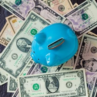 Piggy bank on money backround. top view. saving concept