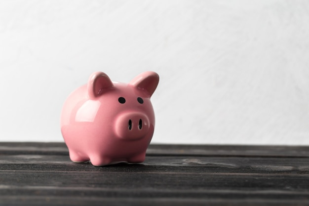 Piggy bank on the old wooden