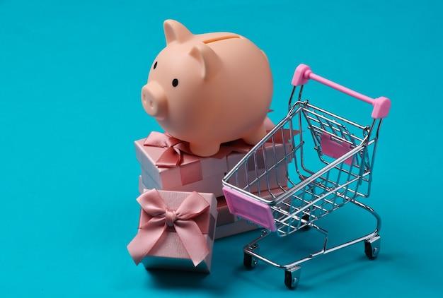ギフトボックス、ショッピングカートのスタックに貯金箱