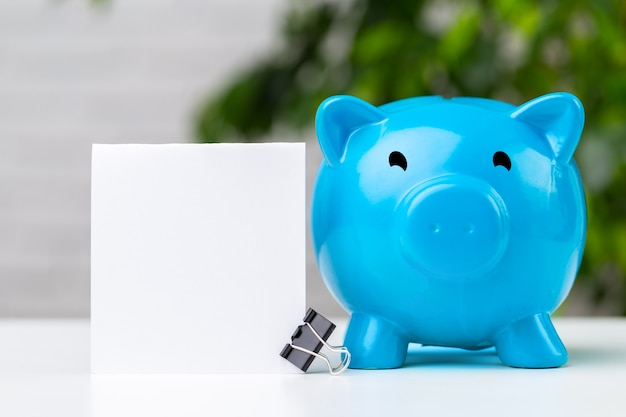 Piggy bank on table with copy space