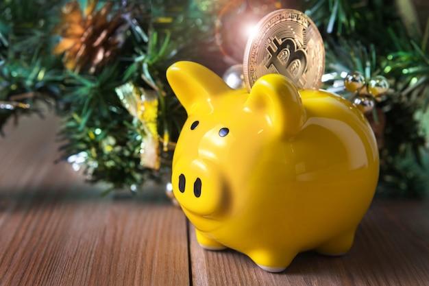 Piggy bank with bitcoin logo