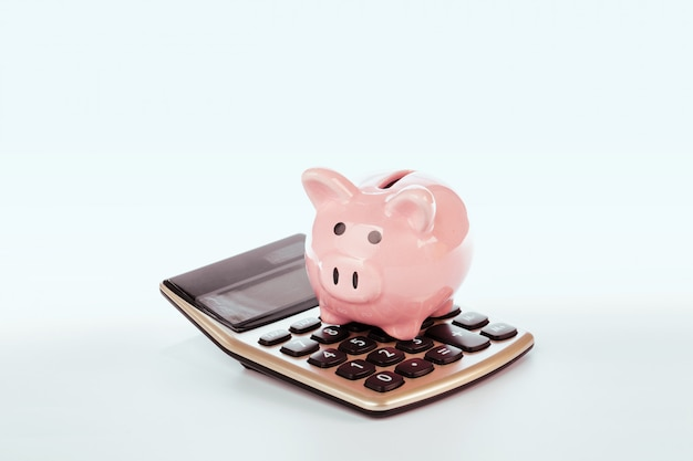 Piggy bank with calculator isolated