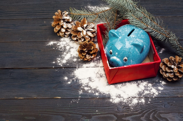 Piggy bank with christmas decoration background.