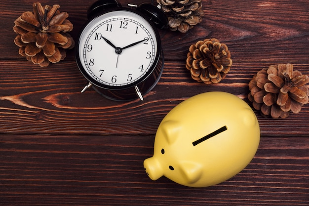 Piggy bank with christmas decoration, christmas composition.