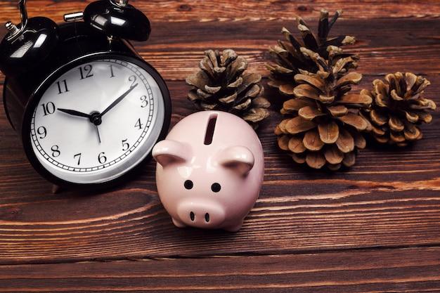 Piggy bank with christmas decoration. christmas composition.