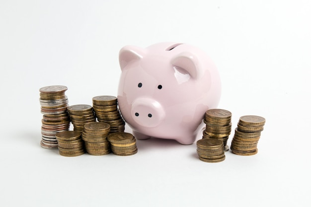 Piggy bank with coin on white background