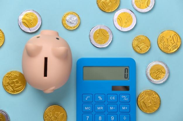 青のコインと電卓の貯金箱