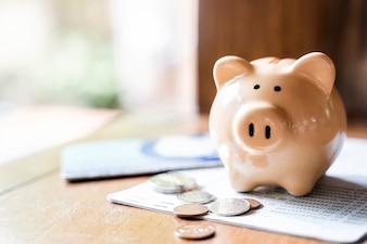 Piggy bank with coins and saving book bank