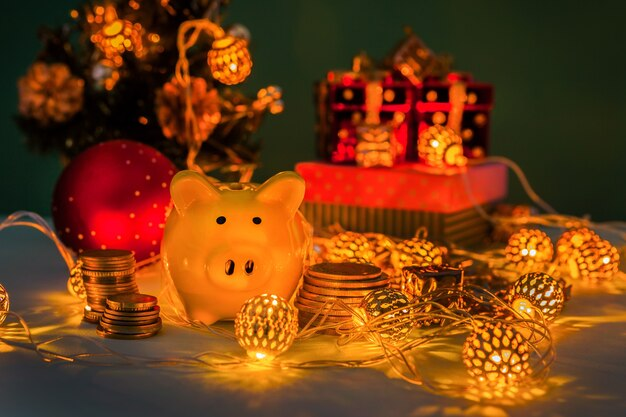 Piggy bank with coins on the table