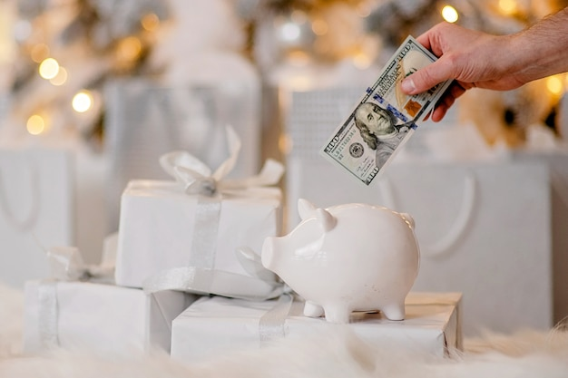 Piggy bank with dollars banknote in festive new year atmosphere