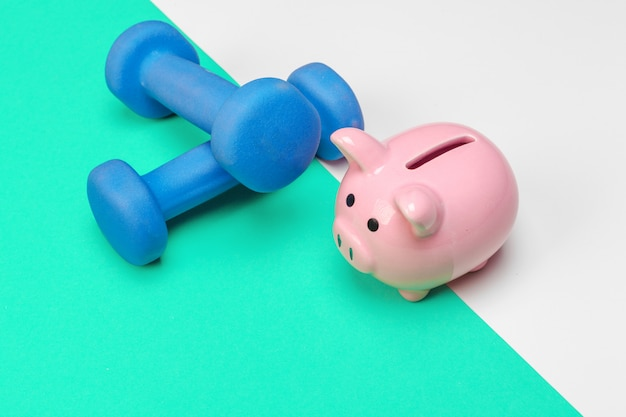 Piggy bank with dumbbells