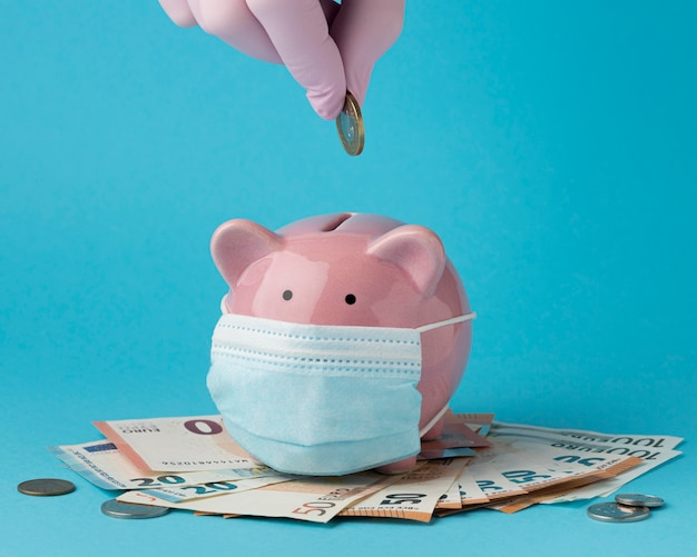 Piggy bank with face mask mask